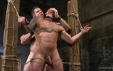 Ground-breaking gay porn in bondage scenes for two bareback hunks