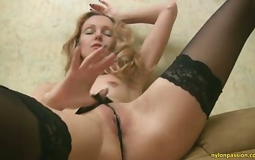 Vivacious and horny minx in black stockings is scraping the brush punani on the chaise longue