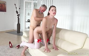 Hot blonde in white underthings and red shoes with high heels is shacking up an elderly man