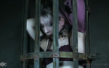 Locked upon the cage dutiful whore Lex Luthor gets ready for hardcore BDSM