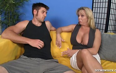 Amber Bach sucks cock with an increment of uses large breasts to titty fuck