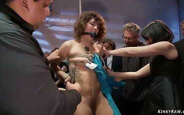 Bound darkhaired babe assfuck toyed in public