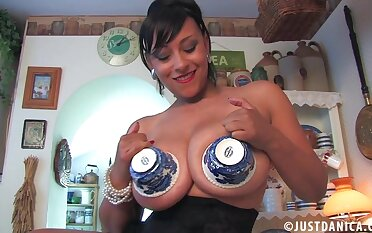 Solo MILF Danica Collins takes off her clothes close by have fun on the table