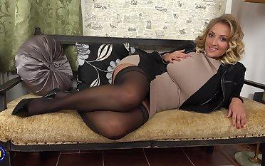 Elegant blonde MILF babe Krystal strips and leaves the high heels on