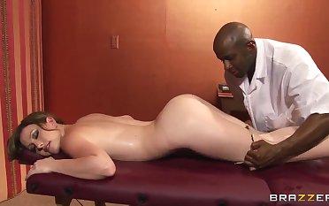 Jennifer White has some fun with a black masseur